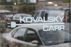Kovalsky Carr logo on glass door