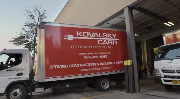 Kovalsky Carr delivery truck with logo on side